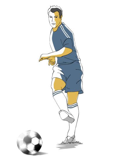 パスキックするサッカー選手